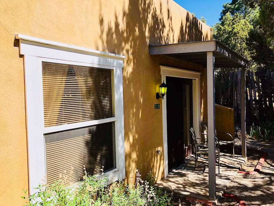Front entrance to the adobe suite, private patio, and walkway to the secluded private garden.