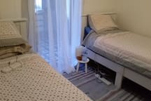 Large bedroom with 2x 3 ft Twin beds and a walk in robe with loads of shelving