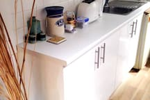 Kitchenette with microwave oven and coffee capsule machine