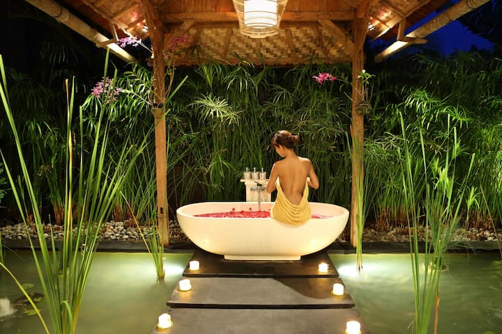 Enjoy the sensation of taking a bath in open air private bathroom
