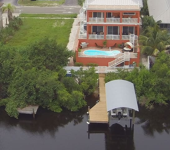 """5 Bed/4 Bath Waterfront """"Lay Low"""" in Apollo Beach"""