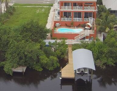 "5 Bed/4 Bath Waterfront ""Lay Low"" in Apollo Beach"