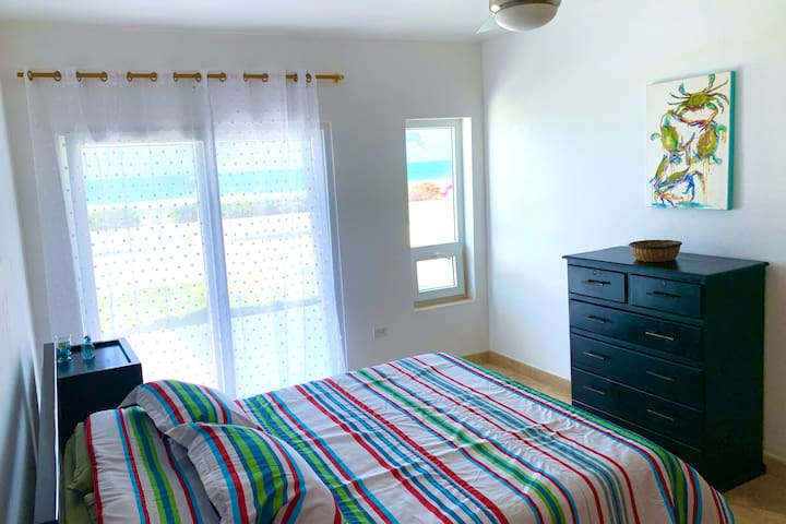 Sleep to ocean sounds...the downstairs queen bedroom has a wonderful beach view.