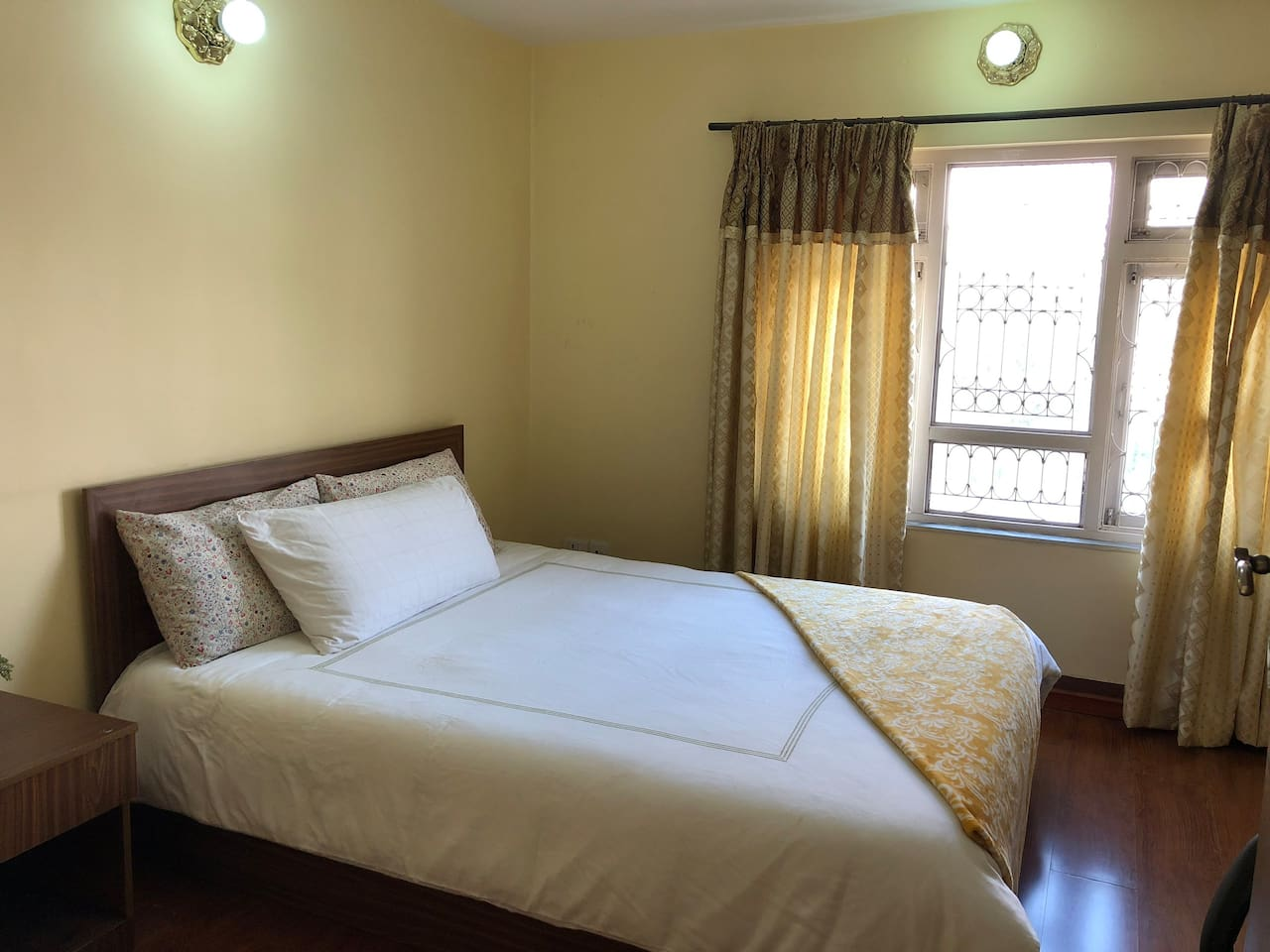 The main bedroom is furnished with a comfortable double bed, nightstand and roomy armoire.