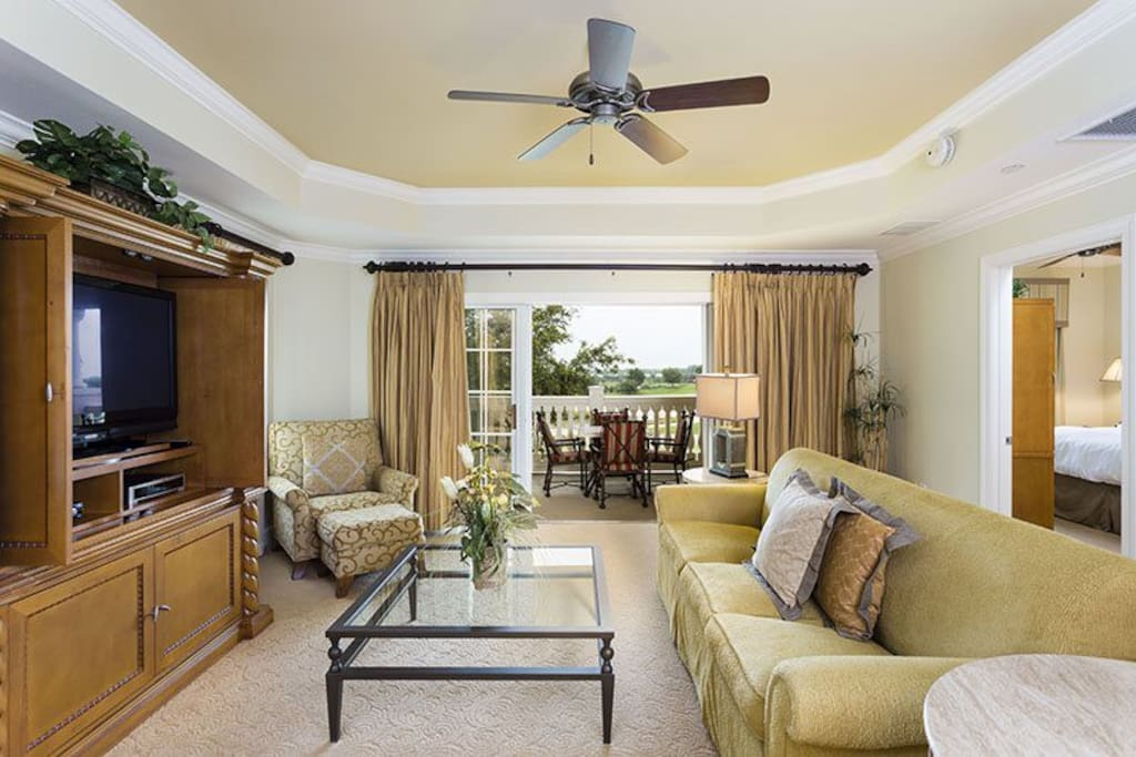 Be surrounded by pure luxury in this beautiful living room offering views of the golf course