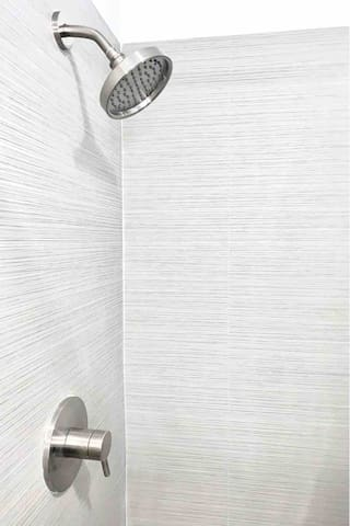 The shower head has a rainfall feel with refreshing water pressure. Not only is it absolutely stunning but it truly feels luxurious, as well.