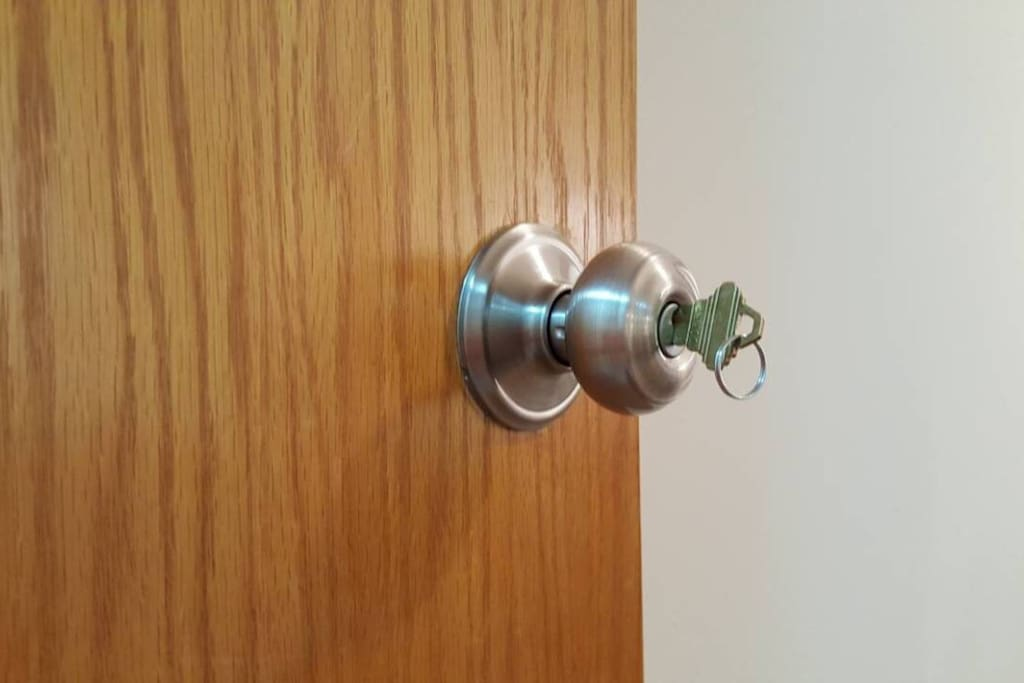 Lock on bedroom door with a key