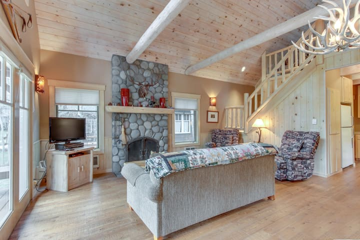 Riverfront cabin w/ cozy fireplace, updated amenities, grill, & deck!