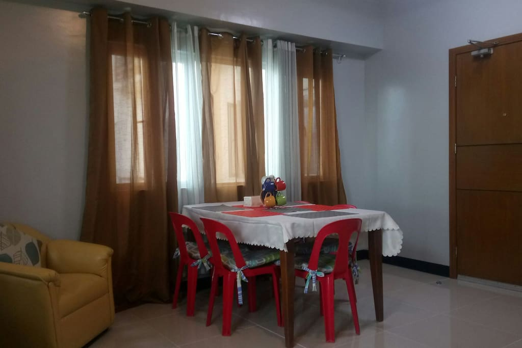 DINNING AREA: 6 Seater dining table, 7 place mat, 5 mug, 4 saucer, 5 monoblock chairs with foam ea. 1 office chair and 1 single seater sofa