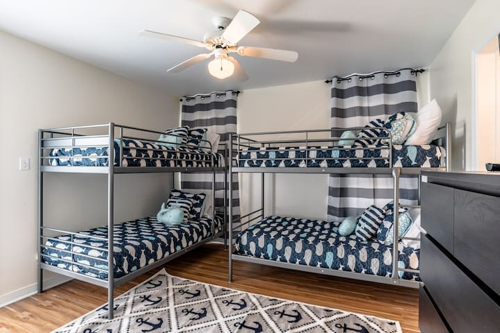 4 twin bunk beds down the hall from the master king suite.