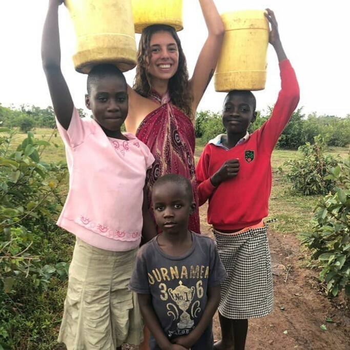 One of our guests volunteered to help the girls bring water back to the village. She learned to cook local food and speak the local language while staying with us!