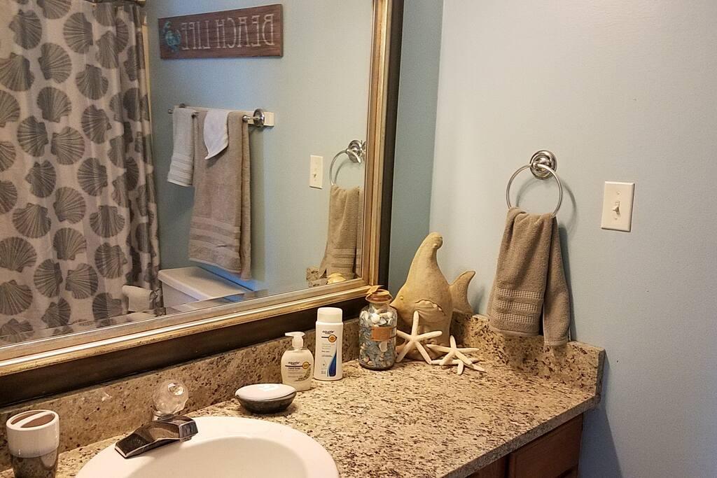 Master bath with shower, half bath off hallway.