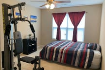 Bedroom with a king-size air bed and personal gym