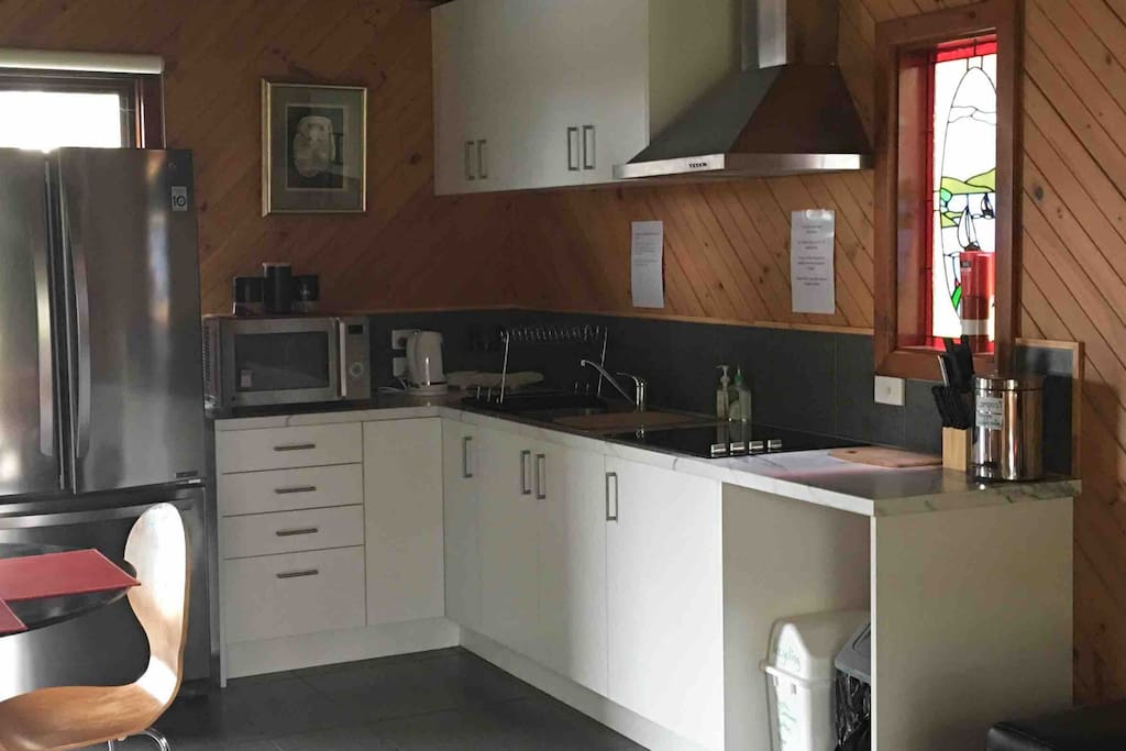Kitchen area will confection microwave , cook top double sink and family size fridge .