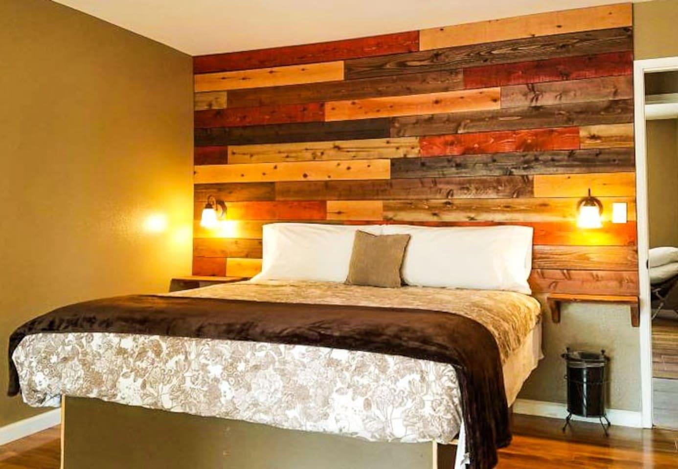 Master bedroom with comfortable amenities.