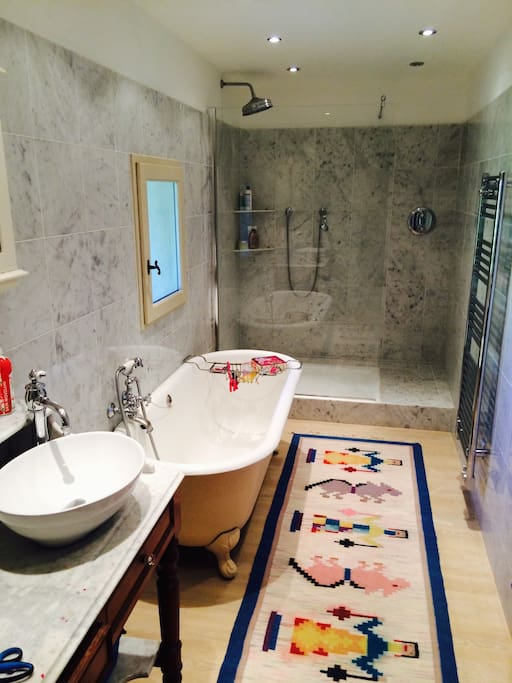 marble bathroom with bath and shower