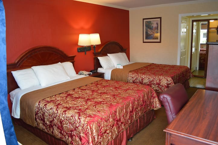 Deluxe Room with Two Queen Beds and Hot Breakfast included. Out door heated pool and hot tub