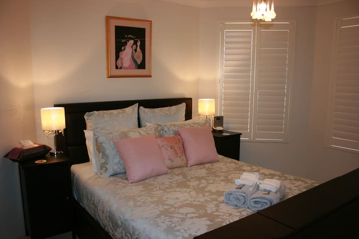 A comfortable Queen bed with an en-suite bathroom in a private air conditioned bedroom.
