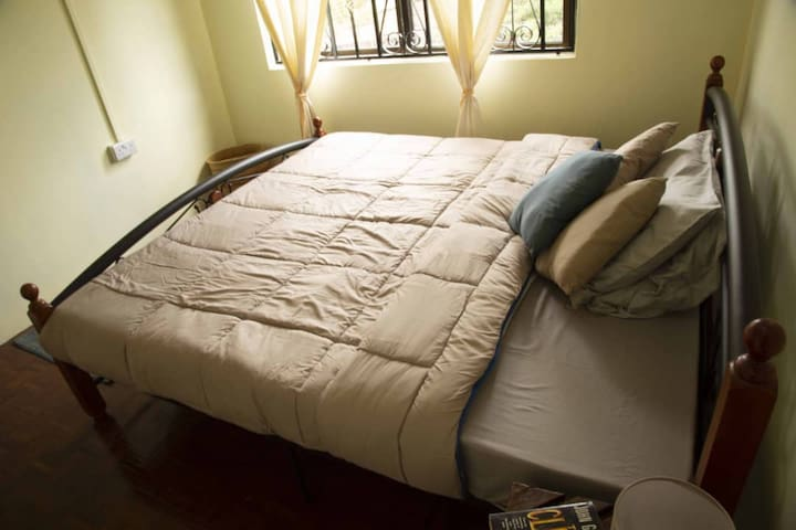 Simba private room with king size bed in Arusha