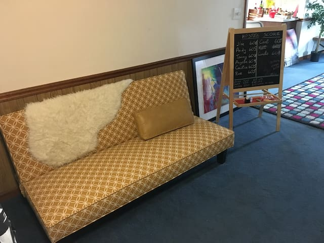 Futon for 2 in the living room in the Hostel