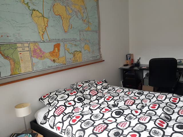 "Cosy bedroom in our ""globe-trotting"" flat"