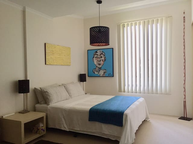 Your queen size bed. Large bedroom with built-in wardrobe and private ensuite bathroom.