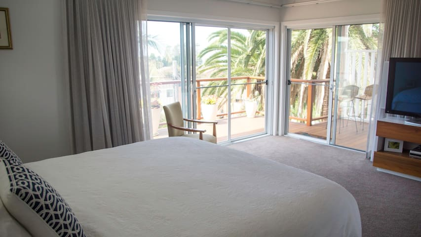 Master Bedroom with king size bed and views to the beach