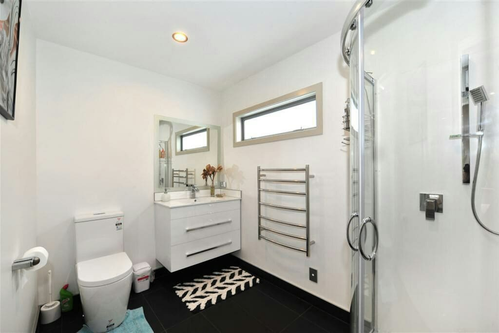 The brand new shower is located upstairs in the master bedroom with shower, toilet, vanity, heated towel rail and bathroom fan heater