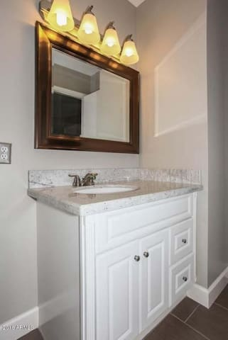 The master bathroom has a sink, cabinet and full size tub/shower