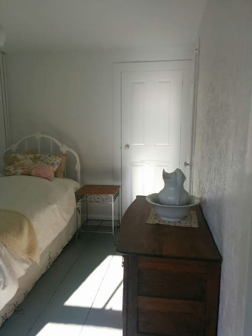 Your room with a comfy bed, antique bureau, night stand, closet, desk and chair.
