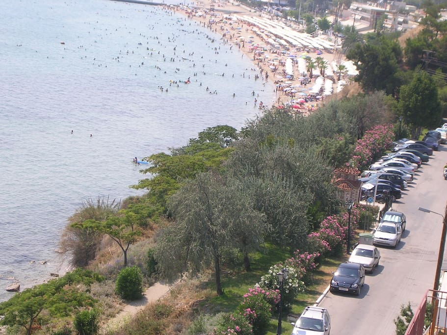 Our street in front of our property. View from the street or top  level apartments.  You see the main beach plaza.