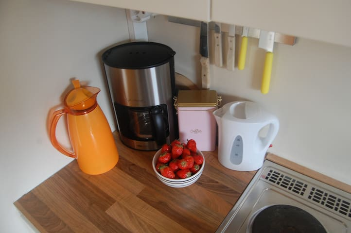 A coffee maker and a water boiler so you can enjoy your coffee, tea or cocoa.