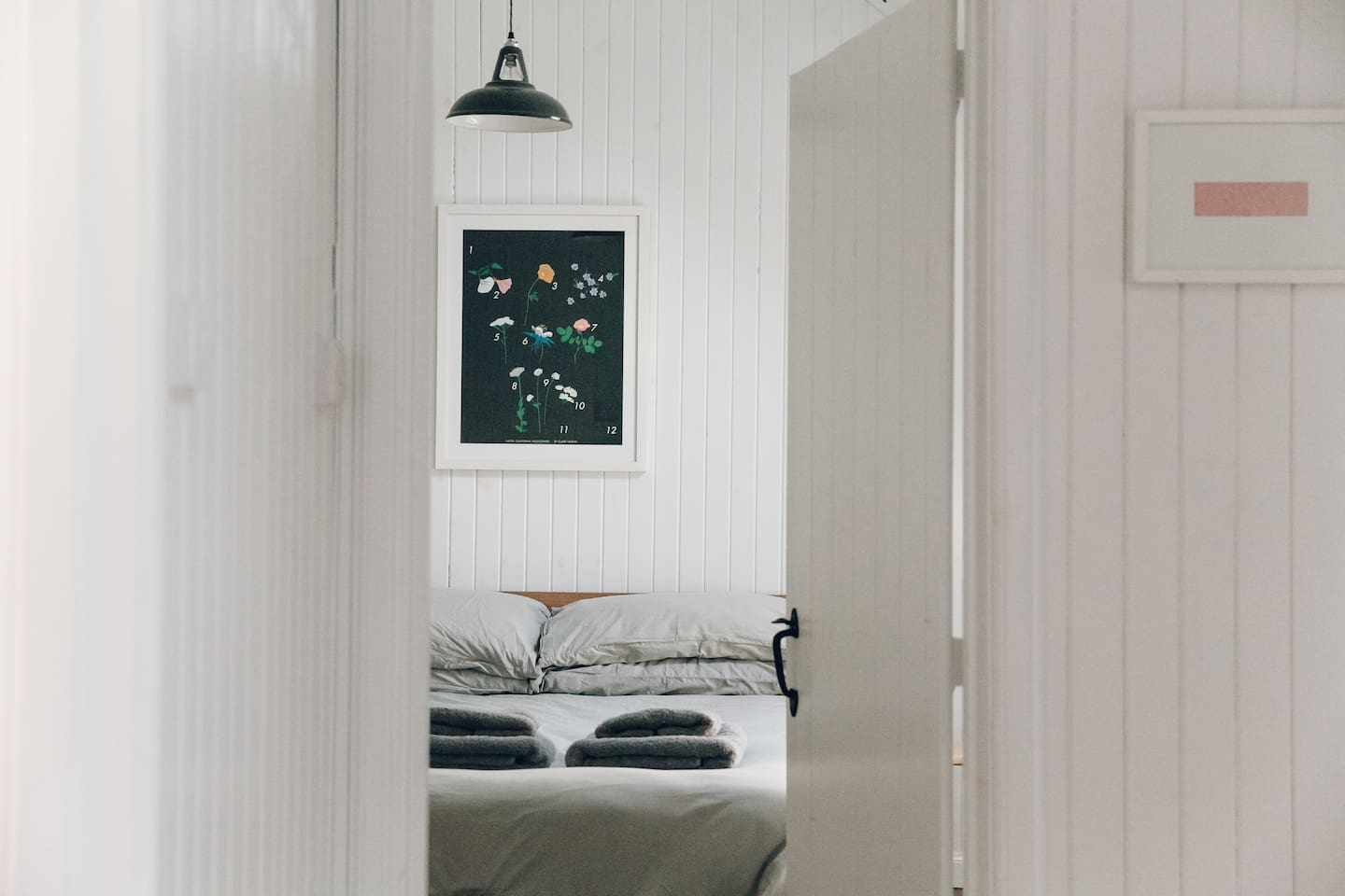 Bedroom with king size bed, cotton bedding, hairdryer
