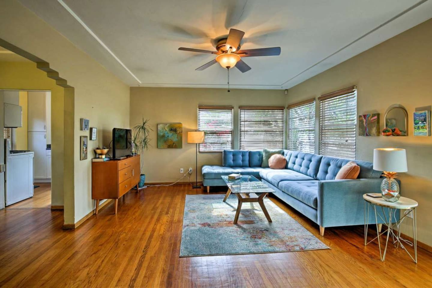 Lounge in the mid-century modern living space in this charming early 1900's house.