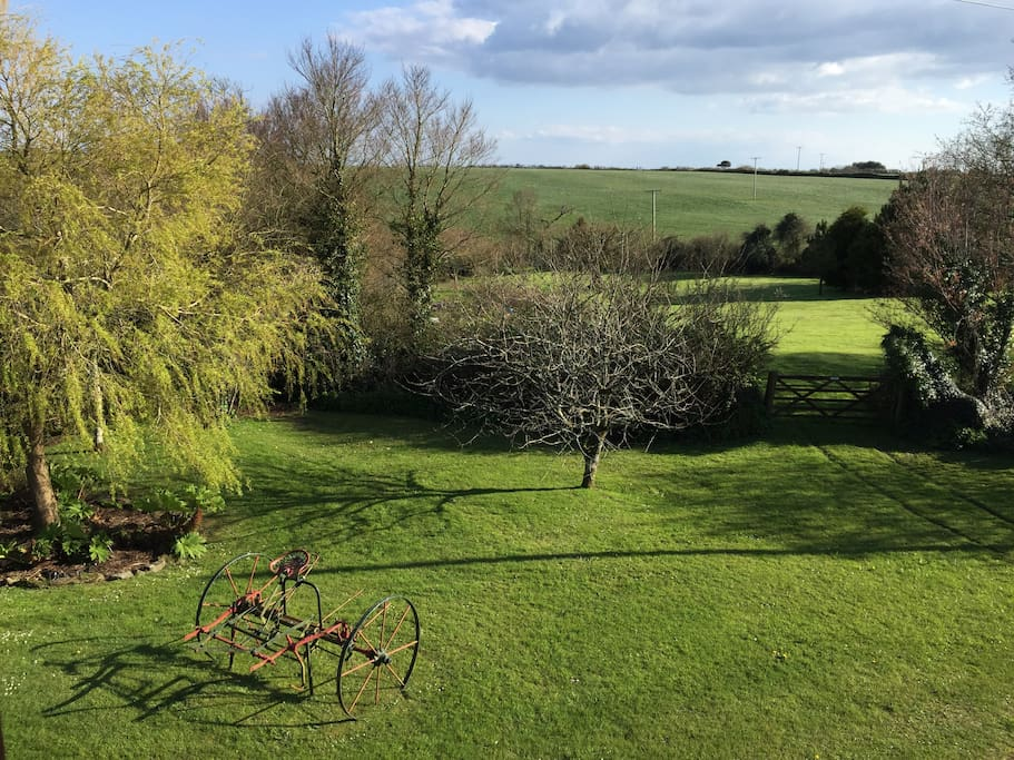 View from double bedroom, of garden and fields beyond