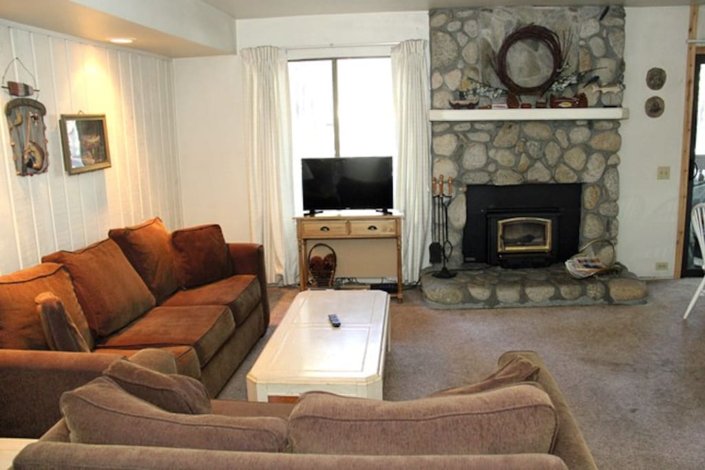 Mammoth Lakes Vacation Rental Sunshine Village 137 -  Living Room with Sofa, Love seat, Wood stove and  Flat Screen TV