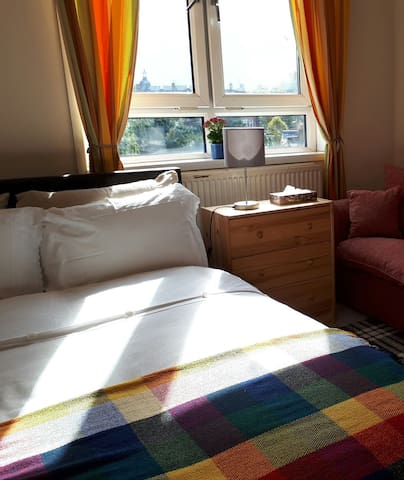 the double bed with soft pillows and warm blanket and a sofa to sit and relax...