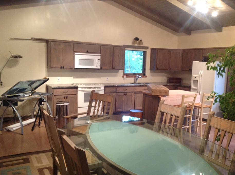 View of conference room table and kitchen from SW corner.