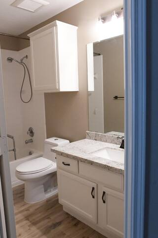 Private Bathroom with shower and bathtub. Recent remodel with granite countertop, new toilet, updated flooring and all new hardware. Bathroom is 4 feet across the hall from your bedroom and is NOT shared. For guest use only.