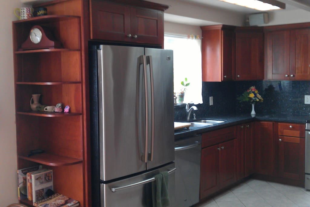Large refrigerator and dish washer.
