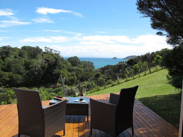 Whero - open plan living, deck with superb views