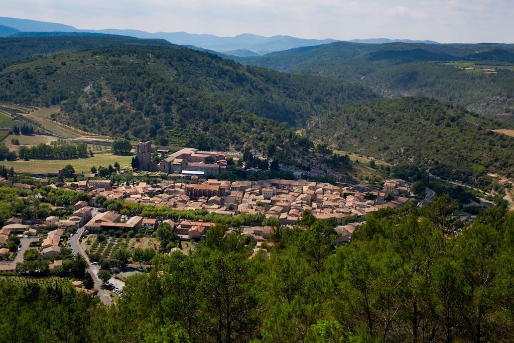 Looking down on the beautiful village of Lagrasse, with the rolling hills of the Corbieres stretching out beyond