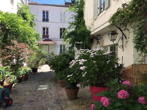 Paříž 12.: nezávislá ložnice na květinovém nádvoří