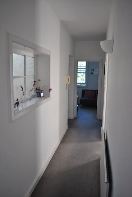 Hallway leading to lounge and separate kitchen