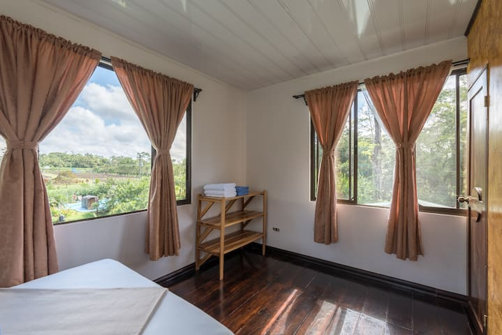 Upstairs bedroom with two double beds and amazing view of the volcano