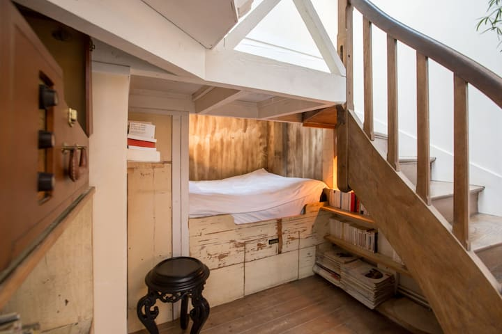 Extra double bed hidden under the stairs (in living room)