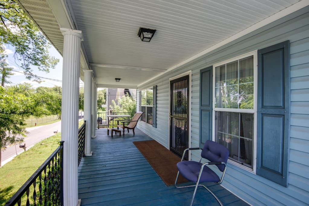 Spacious front porch for a warm afternoon of Southern-style sweet tea sippin'.