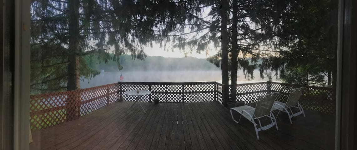 Steam rising over Delaware Lake just after dawn