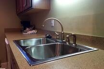 Plenty of counter space with large stainless steel sink.