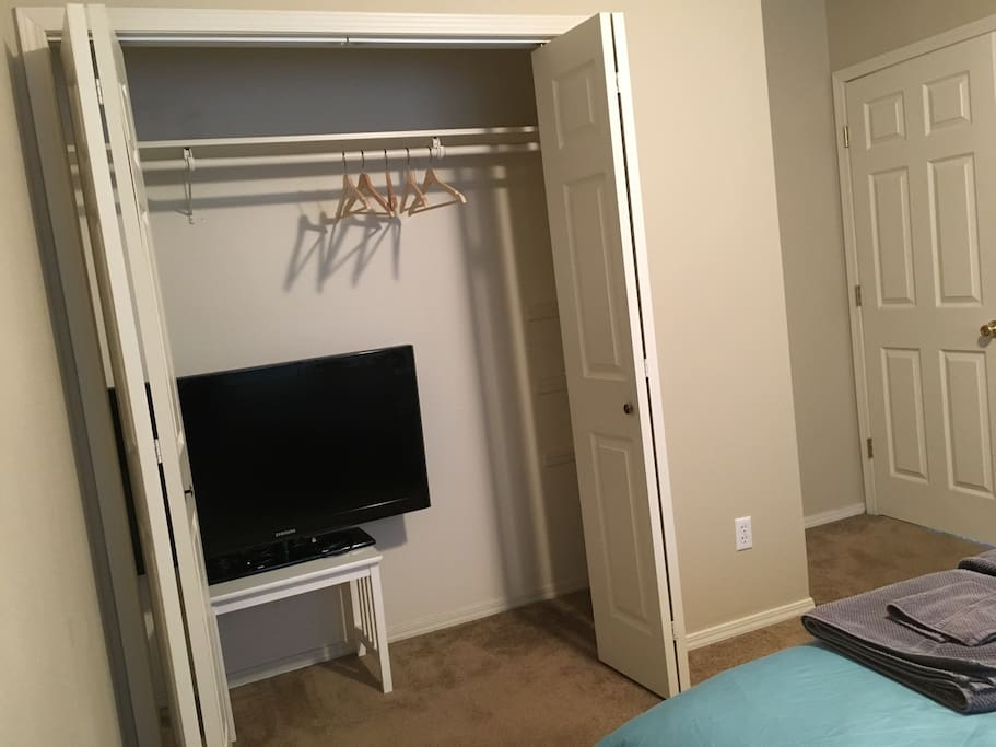 The TV can be hooked up to a computer via HDMI cable. Shelves are on the right side of the closet.